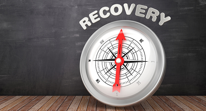 "A compass pointing north at the word ""Recovery."""