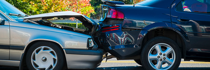 Image of two cars involved in a rear-end collision